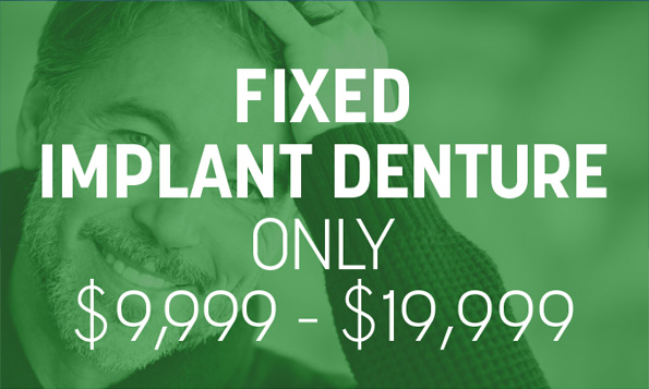 A man smiles beneath a special offer on fixed implant dentures at Lovett Dental Sharpstown