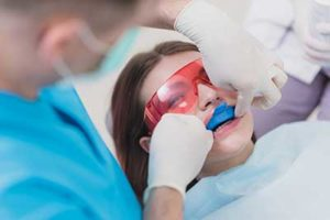 A dentist gives his patient fluoride treatments in TX