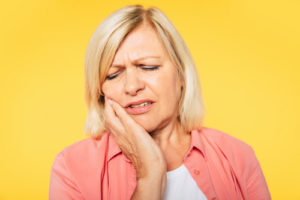 a woman trying to deal with Impacted Teeth