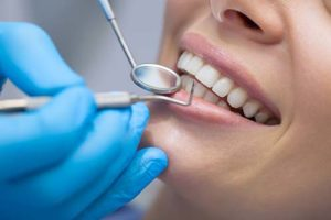 woman gets specialty dentistry