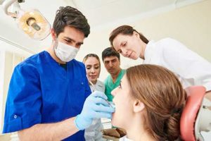 a man works on his orthodontics patient